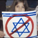 video_still.girl_with_sign.israel_prohibited